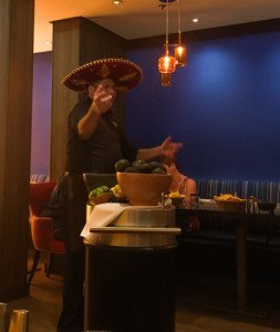 Man in a sombrero teaching guacamole class